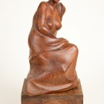 Seated Woman, Mulberry, 15x10x7, 1993. Pose taken from an unfired clay study done at the Cambridge Center for Adult Education. Wood from Duxbury, Massachusetts.