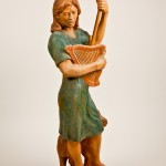 "Shepherdess, elm, 38x12x11, 1997. The pose derives from that of the Michelangelo ""Risen Christ""."