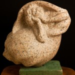 "Lorelei, red granite, 16""x16""x12"", 2002. Local stone."