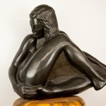 "Seated Girl, basalt, 26""x24""x13"", 2012. Carved from boulder taken from a Sullivan gravel pit."